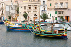 Luzzu fishing vessels in Kalkara Creek Stock Photo