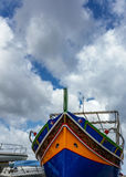 Luzzu on land - Traditional Maltese fishing boat Stock Photography