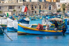 Luzzu Marsaxlokk harbour. Traditional colourful Maltese Luzzu fishing boats in the turquoise blue water of Marsaxlokk harbour, Marsaxlokk, Malta, June 2017 Royalty Free Stock Images