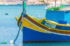 Luzzu Marsaxlokk harbour. Traditional colourful Maltese Luzzu fishing boats in the turquoise blue water of Marsaxlokk harbour, Marsaxlokk, Malta, June 2017 Stock Images