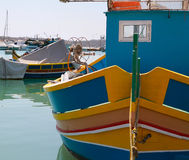 A luzzu in marsaxlokk's harbour Royalty Free Stock Photography