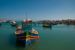 Luzzus in Marsaxlokk, Malta. Marsaxlokk is quiet fishing village in Malta. The colourful traditional fishing boats are called Luzzus which dated back to 800 BC Royalty Free Stock Image