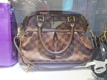 LV bags. On display at a pre-own reseller store in Singapore royalty free stock image