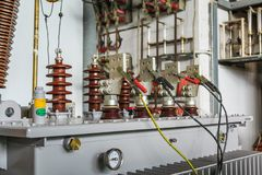 LV terminals of transformer under induced voltage test. Three phase oil immersed transformer under induced over voltage test, focusing on LV terminals which are Stock Photography