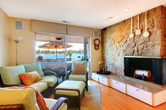 Lving room with fireplace and lake view. Stock Images