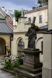 Lviv. Ancient statue of Christ carrying the Cross, in the yard of the Armenian Church in Lviv Royalty Free Stock Photography