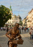 Lviv. Beautiful summer view of the Market Square in Lviv, a living sculpture in the center of the frame Stock Image