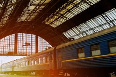 Lviv Central Station iron arches empty platform of ancient at early morning. Iron arches and empty platform of ancient Lviv Central Station at early morning royalty free stock photo