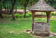 Lviv city center. Water well on green grass in Lviv, Ukraine Royalty Free Stock Photography