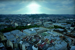 Lviv old city panorama view in cloudy weather. Sky, clouds and sunshine processed and added in Adobe Photoshop stock photography