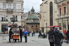 Lviv's main square,  medieval architecture, tourists and townspeople Stock Photo