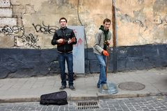 Lviv street musicians. Lviv, Ukraine - July 27, 2013: street musicians are one of the highlights of an ancient Ukrainian city stock images