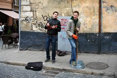 Lviv street musicians. Lviv, Ukraine - July 27, 2013: street musicians are one of the highlights of an ancient Ukrainian city stock photos