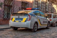 LVIV UKRAINA, WRZESIEŃ, - 08, 2016: Lviv samochód policyjny i miasto Obraz Royalty Free