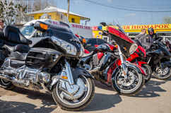 LVIV, UKRAINE - APRIL, 2016: Black chrome Harley Davidson motorcycles and other sports motorcycles in the parking lot of members o Royalty Free Stock Photos
