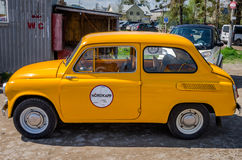 LVIV, UKRAINE - APRIL, 2016: Old vintage small car brand Zaporozhets ZAZ yellow on the retro car show Stock Images