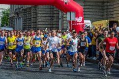 LVIV, UKRAINE - APRIL, 2016: Participants of marathon athletes run start take on Prospect of Freedom in Lviv, Ukraine. Participants of marathon athletes run Royalty Free Stock Photo