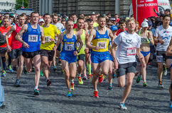 LVIV, UKRAINE - APRIL, 2016: Participants of marathon athletes run start take on Prospect of Freedom in Lviv, Ukraine. Participants of marathon athletes run Stock Photography