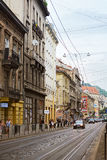 Lviv, Ukraine - August 5, 2015: Lviv cityscape. View of Lviv street with the old architecture, cars and people walking. Stock Photos