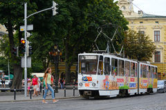 Lviv, Ukraine - August 5, 2015: Lviv cityscape. View of Lviv street with the old architecture, tram and people Royalty Free Stock Images