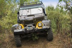 Off-road vehicle brand GAZ-69UAZ overcomes the track. Lviv, Ukraine - August 23, 2015: Off-road vehicle brand GAZ-69 UAZ overcomes the track on of sandy career Royalty Free Stock Images