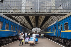 LVIV, UKRAINE - AUGUST 21, 2015: People getting prepared to board a train on the platforms of Lviv train station. Picture of Ukrainian tourists boarding a Royalty Free Stock Photography