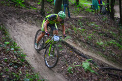 Lviv, Ukraine - August 17, 2016: 4th round of amateur xc cup of Ukraine 2016. Lviv, Ukraine - August 17, 2016: MTB cyclist E. Zakora competing in the forest Stock Images