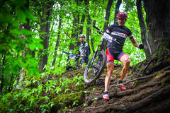 Lviv, Ukraine - August 17, 2016: 4th round of amateur xc cup of Ukraine 2016. Lviv, Ukraine - August 17, 2016: MTB cyclist A. Hryn competing in the forest near Royalty Free Stock Photos