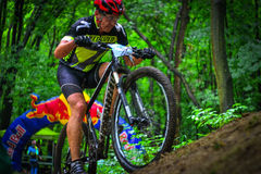 Lviv, Ukraine - August 17, 2016: 4th round of amateur xc cup of Ukraine 2016. Lviv, Ukraine - August 17, 2016: MTB cyclist R. Boichuk competing in the forest Royalty Free Stock Photo