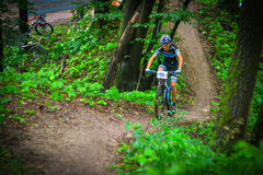 Lviv, Ukraine - August 17, 2016: 4th round of amateur xc cup of Ukraine 2016. Lviv, Ukraine - August 17, 2016: MTB cyclist V. Skubenko competing in the forest Stock Images