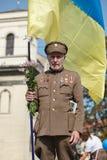Lviv, UKRAINE - August 24, 2017: A veteran of the Ukrainian Insurgent Army holds a flag of Ukraine stock photos