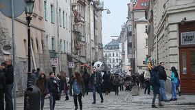 LVIV, UKRAINE - February 28, 2015 Busy street in center Lviv with tram riding stock video