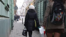 LVIV, UKRAINE - February 28, 2015 Busy street in center Lviv with tram riding stock video footage