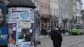 LVIV, UKRAINE - February 28, 2015 Lviv central square busy with pedestrians walking and tram riding stock video