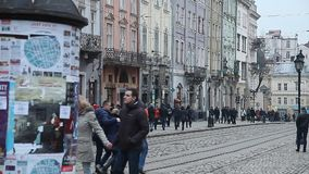 LVIV, UKRAINE - February 28, 2015 Lviv central square busy with pedestrians walking and tram riding. LVIV, UKRAINE - February 28, 2015 Lviv central square busy stock footage
