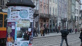 LVIV, UKRAINE - February 28, 2015 Lviv central square busy with pedestrians walking and tram riding. LVIV, UKRAINE - February 28, 2015 Lviv central square busy stock video
