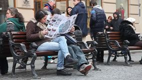 LVIV, UKRAINE - February 28, 2015 Two tourists studying sightseeing map stock video