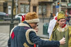 Unknown young people, in theatrical costumes, are photographed b. Lviv, Ukraine - January 07, 2018: Christmas events in the center of the city. Unknown young stock images
