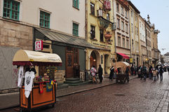Lviv, Ukraine - January 24, 2015: Lviv cityscape. View of Lviv street with the old architecture, souvenir shop and walking touris. The old streets of Lviv with Royalty Free Stock Photography