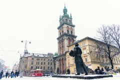Lviv, Ukraine - January 21, 2018: Monument to Ivan Fedorov forefront, Stauropegial Church of the Assumption, Chapel of the Three S. Aints and First city stock photo