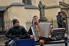 Lviv, Ukraine - January 24, 2015: Street musician plays on the central square of the city Lviv. Photo of street musicians in Lviv Stock Image