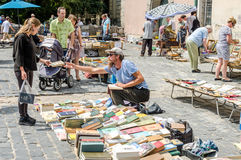 Lviv, Ukraine - July 2015: Men and women choose and buy, and sellers are selling old rare books and vintage items in the book mark Royalty Free Stock Photography