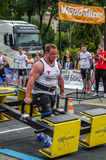 LVIV, UKRAINE - JULY 2016: Strong athlete bodybuilder strongman carries heavy metal design competitions World Strongest Team befor Stock Photos