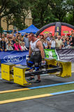 LVIV, UKRAINE - JULY 2016: Strong athlete bodybuilder strongman carries heavy metal design competitions World Strongest Team befor Royalty Free Stock Photography