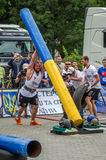 LVIV, UKRAINE - JULY 2016: Strong athlete bodybuilder strongman carries heavy metal design competitions World Strongest Team befor Stock Image