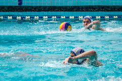 Lviv, Ukraine - July 2015: Ukrainian Cup water polo. Athlete team's water polo ball in a swimming pool and makes attacking shot on Stock Photography