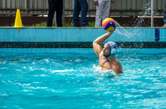 Lviv, Ukraine - July 2015: Ukrainian Cup water polo. Athlete team's water polo ball in a swimming pool and makes attacking shot on Royalty Free Stock Image