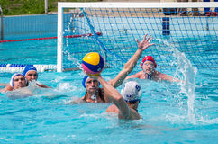 Lviv, Ukraine - July 2015: Ukrainian Cup water polo. Athlete team's water polo ball in a swimming pool and makes attacking shot on Royalty Free Stock Photos