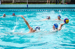 Lviv, Ukraine - July 2015: Ukrainian Cup water polo. Athlete team's water polo ball in a swimming pool and makes attacking shot on Stock Photos