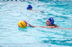 Lviv, Ukraine - July 2015: Ukrainian Cup water polo. Athlete team's water polo ball in a swimming pool and makes attacking shot on Royalty Free Stock Photo